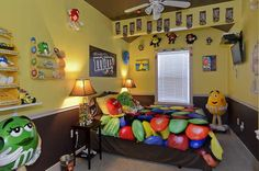 M&M candy themed bedroom-  A lot of things I don't like about this room, but I like the M&M lamp and the white trim around the window with the little M&M accents.