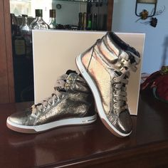 Michael kors fashion sneakers PRICE DOR SHOE SIZE 7 ONLY.....New Michael kors shoes  Size 7 women's and size 2 baby There slightly different color but really similar. Perfect to match with your little one! Price for bundle! Size 7 $100 Baby shoes size 2 $30 Michael Kors Shoes Sneakers