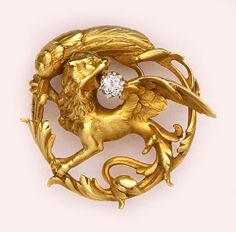 French carved gold and diamond gryphon brooch