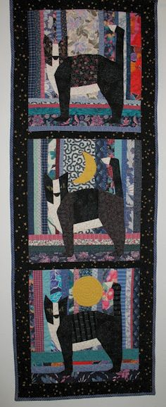 Black cat quilt with scrappy background