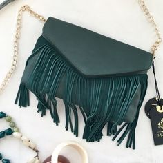 """HP Hunter green fringed crossbody handbag Gorgeous! Chic, with a boho edge. Deep hunter green leather and faux leather, and honestly, the bag looks and feels so good, I can't tell which is which. One front flap, with long fringe embellishment. Gold chain with leather (or """"leather"""") at the shoulder for comfort. NWT; never worn. Moda Luxe Bags Crossbody Bags"""