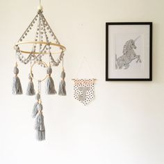 Grey cot mobile – boho nursery decor by Chief Thundercloud! Handmade yarn tassel mobile made with pompom trim, rattan/cane hoop, wooden beads and copper and brass accents in grey. Please see third photo for tassel bead options. Each mobile is made to order and is made and assembled by hand with care and consideration. All tassels are made and tied by me and the pompom trim is hand stitched to the rattan hoop. Due to the handmade nature of this product, slight variations may occur to m...