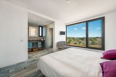 Minimalist master bedroom with spectacular views of the Spanish countryside.