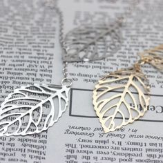 BRAND NEW -Double Leaf Necklace Bundle Deal Brand New & Comes Packaged! Perfect for all events, occasions and even as gifts! ALL ORDERS ARE SHIPPED THE SAME DAY -Length: 50cm -Bundle comes with both gold and silver necklace Jewelry Necklaces