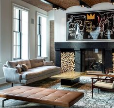 Eclectic and Masculine Den, with Black Stone Fire place, Suede Danish Sofa, and Caramel Leather Daybed.