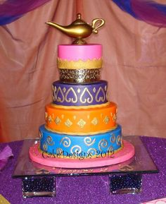 "6, 8, 10 &12 x 3"" for an arabian nights quinceanero iced in buttercream with fondant decorations.  Gold painted with airbrush and p..."