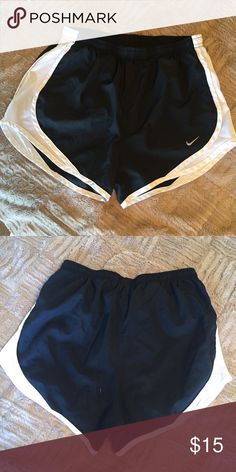 NIKE shorts women's Women's black Nike shorts with white sides. No color faded - In great shape! Size XS Nike Shorts