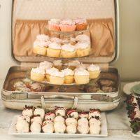 French Infused Bridal Shower. Vintage suitcase with cupcakes