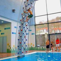 Poolside Rock Climbing Wall! This seriously looks like the most fun ever!