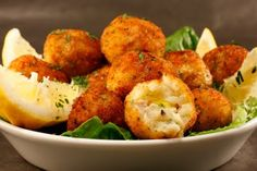 Fried cod fish balls are a different kind of appetizer. a mixture of cod, potatoes, garlic and parsley. 1 pound cod fish 3 potatoes 2 tablespoons flour 1 egg 3 garlic cloves, minced 1 tablespoon fresh parsley salt and pepper to taste 1/2 cup Italian breadcrumbs 1 lemon olive oil for frying