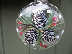 Items similar to Hand painted glass ornament with berries and pinecones on Etsy