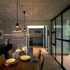 Inside out chevron floor pattern extends from eating area to patio; floor to ceiling windows