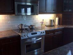dark cabinet, counter, use light backsplash with under cabinet lights