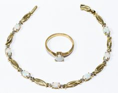 Lot 207: 10k Gold and Opal Jewelry Assortment; Including ring having heart cut cabochon opal and bracelet having oval cut cabochon horizontally set opals; both marked 10k