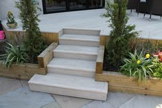 Raised deck Millboard terrace with steps leading down to a sun terrace. Patio Design, Sloped Garden, Side Garden, Landscaping Around Trees, Backyard Landscaping Designs, Back Garden Design, Garden Bar Shed