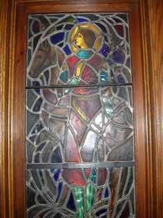 """This window is an adaptation of the well known painting by George Frederick Watts which, in turn, had as its inspiration the equally well known poem of """"Sir Galahad"""" by Alfred Tennyson.   It was installed to honor the Sir Galahad youth movement at All Saints'.   Sir Galahad is shown clad in armor and the flowing robe which medieval knights wore.   All Saints Episcopal Church, Pontiac MI"""