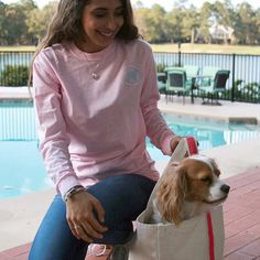 """SOPHIE loved sitting in this Southern Girl Prep canvas boat tote during the photo shoot. She didn't want to get out when we finished. Come check out this tote and """"Southern State of Mind"""" long sleeve tee at southerngirlprep.com or click link in bio."""