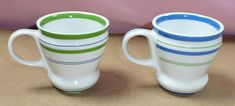 "Set of 2 Starbucks small espresso coffee mugs/cups with stripe pattern from 2007.  Each cup holds 3 ounces and measures 2 1/2"" tall and  2 3/8"" wide without handle, 3 3/8"" wide including handle."
