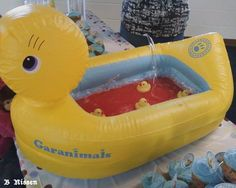 Baby tub filled with punch and floating baby rubber duckies