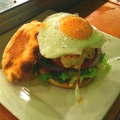 Breakfast burger on an English muffin with a over easy egg and hollandaise sauce!