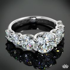 Seven seas:  Custom Diamond Engagement Ring features a graduating row of A CUT ABOVE® Hearts and Arrows Diamonds leading to a brilliant 1.60ct A CUT ABOVE® Hearts and Arrows Diamond. The U-Prong design allows for maximum visibility of the diamonds.