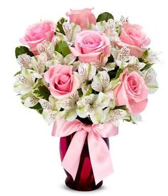 Sweet as Pink You have to agree, this is as graceful an arrangement as you've ever set your eyes on. Indeed, sophistication gets new meaning as pink roses and white alstroemeria elegantly fill a pink