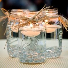 Mason Jars and Candles Keep it simple and use floating candles as your centerpiece. They'll glisten in clear Mason jars. Mason Jars and Candles Keep it simple and use floating… Party Planning, Wedding Planning, Dream Wedding, Wedding Day, Trendy Wedding, Wedding Simple, Wedding Rustic, Decor Wedding, Wedding Signs