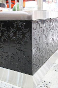 Pressed tin Melbourne panels look fantastic painted black on this counter.