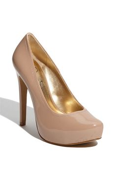 Classic almond-toe pump is balanced atop a towering stiletto heel and hidden platform.