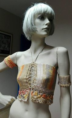 This is a boho inspired crochet top. It can be worn with jeans ,shorts or a gypsy skirt. Really cool for the summer since it is made with cotton yarn. Can be made in sizes s/m .