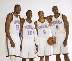 Oklahoma City Thunder's, from left, Kevin Durant, Reggie Jackson, Russell Westbrook and Serge Ibaka pose for photos during NBA basketball media day at Chesapeake Energy Arena, Monday, Sept. 29, 2014 in Oklahoma City. (AP Photo/Brett Deering)