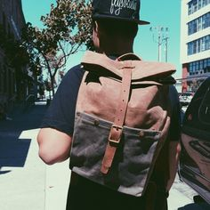 Mere-Made Buttery soft waxed canvas backpack with roomy pockets, leather straps and antiqued brass hardware. Available in Tan, Olive and unwaxed brown $200 #oaksupplyco #madeinamerica #oakland #waxedcanvas #backpack | oaksupply.co