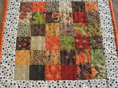 Beautiful quilted patchwork table topper in rich autumn colors of orange, brown, green, gold, rust an cream. Display on kitchen or dining table, coffee table, sofa table, service hutch or any flat surface.  The table topper is made from quilt shop quality cotton fabric. There is a layer of cotton batting between the fabrics. The backing fabric is a gold, black and orange print. The binding is machine stitched to the front and hand stitched to the back for a durable and professional finish…