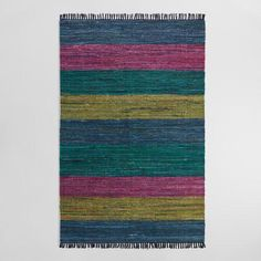 Hand block printed in Jaipur, India, on a handwoven, striped chindi base, our reversible rug is a work of art. Each pattern is stamped by artisans using hand-carved wooden blocks, resulting in subtle color and design variations that make each rug unique.