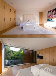 This modern bedroom has a wall full of wood cabinetry with contrasting black hardware, and it also opens up to a balcony.