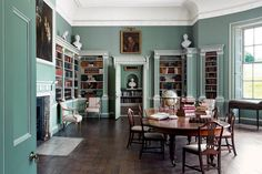 The Adam design of the library remains untouched at Ugbrooke Park, complete with giltwood chairs.