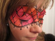 Lace mask in orange and pink, face paint