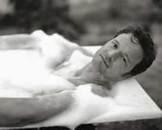 Colin Firth looking handsome and at peace in a bubbly bath.