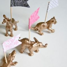 Transform plastic animals from the toy store into sophisticated gold placeholders fit for your next adult soiree.