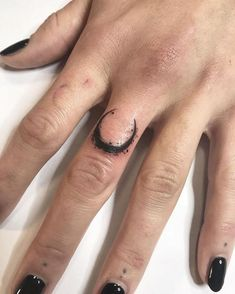 crescent moon tattoo, on the middle finger, finger tattoos, hand resting on a white countertop Middle Finger Tattoos, Finger Tattoo For Women, Cute Tattoos For Women, Finger Tattoo Designs, Back Tattoo Women, Tattoos For Guys, Emo Tattoos, Bild Tattoos, Feather Tattoos