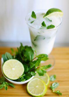 Coconut-Lime Mojito (1 1/2 shot clear rum     Splash of simple syrup    Lime wedge    Fresh mint leaves    Splash of coconut milk    Lemon-lime soda    Club Soda)