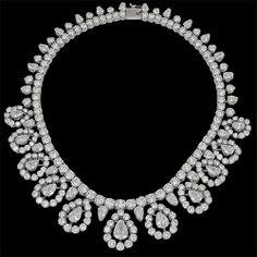 Circa 1950's platinum pear shape diamond and round diamond necklace. 9 pear shape diamond - approx.18cts. and 24 pear shape diamond 20cts.