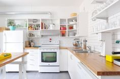 this might be the best quick & dirty fix - remover upper shelving doors, paint white, slap on a butcher block counter top!