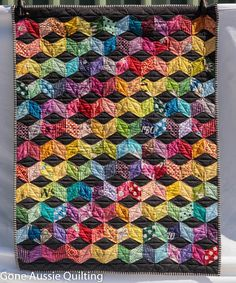 Gone Aussie Quilting: Finished Quilt Favorites.    Look at all of the wonderful, colorful quilts in this post.... lots of them.