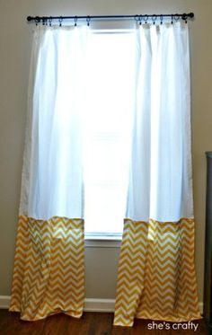 Store bought curtains with fabric panels added to the bottom to make them longer.