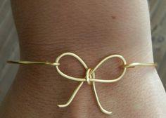 Darling bow bangle. Bridesmaid bracelet.  14k gold.. $20.25, via Etsy.