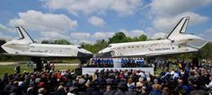 Space shuttles Enterprise, left, and Discovery meet nose-to-nose at the beginning of a transfer ceremony at the Smithsonian's Steven F. Udvar-Hazy Center, Thursday, April 19, 2012, in Chantilly, Virginia.