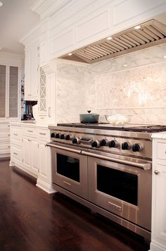 One of best white kitchens ever. Especially love this marble and how it is laid behind this cook center. Libby Palmieri, designer