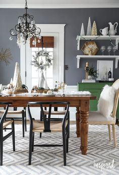 Holiday Home Tour Michael Wurm Jr. of Inspired by Charm share his 2016 home eclectically decorated for the holiday season.