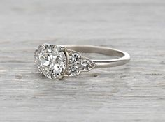 Vintage Edwardian platinum engagement ring centered with an EGL certified 1.04 carat old European cut diamond with H-I color and SI1 clarity. Circa 1915
